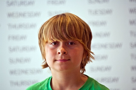 portrait of a cute boy in the museum photo