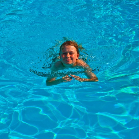 smiling child has fun in the pool Stock Photo - 9220010