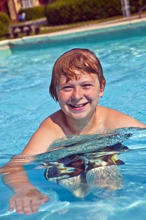 child has fun in the pool Stock Photo - 9220511