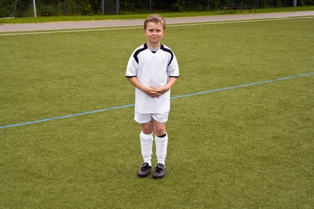 proud player for a young youth soccer team looks proud in his tricot photo