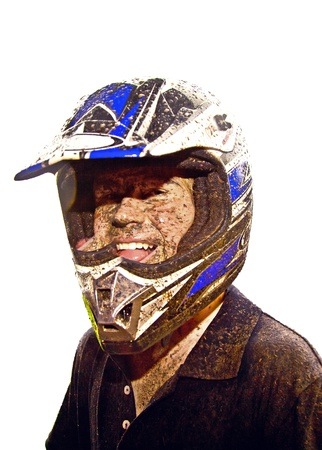 boy has dirt in his face from driving Quad in rain photo