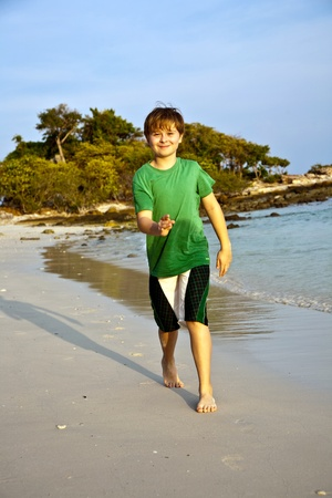 happy young boy is running along the beautiful Stock Photo - 9221596