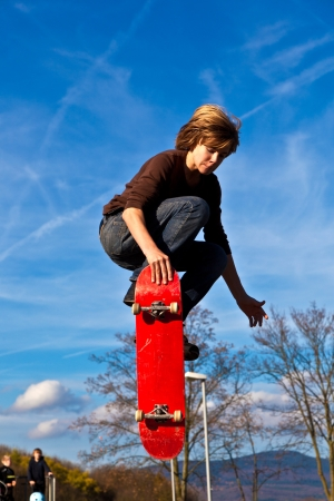 boy junping with skateboard photo