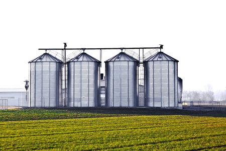 silver silos in the field photo