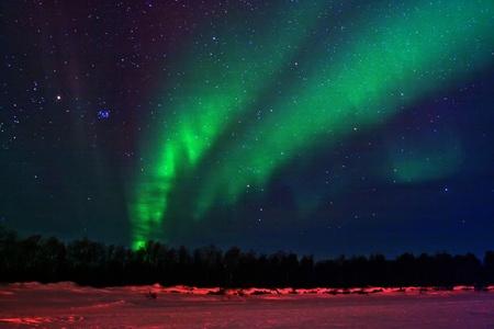Northern lights (aurora borealis) display near Kaamanen, Finland photo