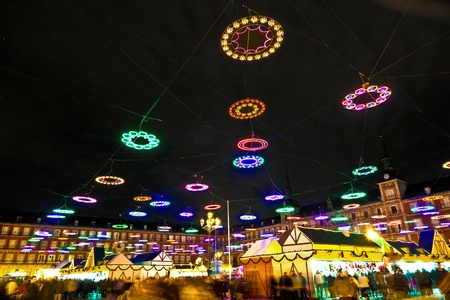 christmas in the city: illumination in Madrids Christmas market at the Plaza major Stock Photo