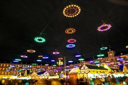 market hall: illumination in Madrids Christmas market at the Plaza major Stock Photo