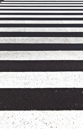 signs for pedestrian crossing are painted on the street photo