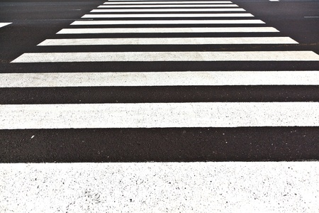 crosswalk: signs for pedestrian crossing are painted on the street