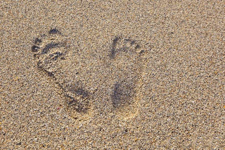 standpoint: footprints in the sandy beach