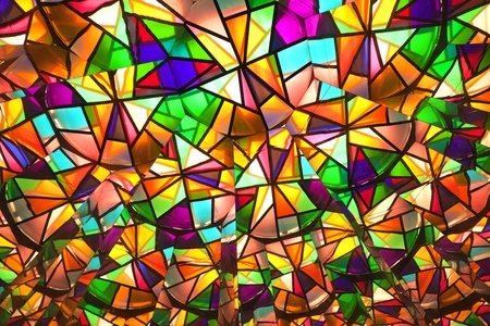 beautiful colored glass windows with asymetric pieces of different colors Stock Photo
