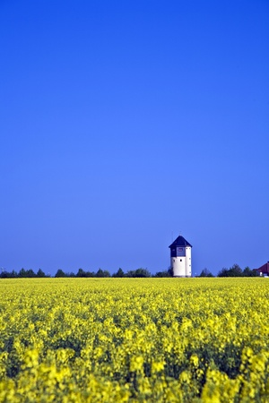 the water tower: water tower in beautiful landscape with blue sky