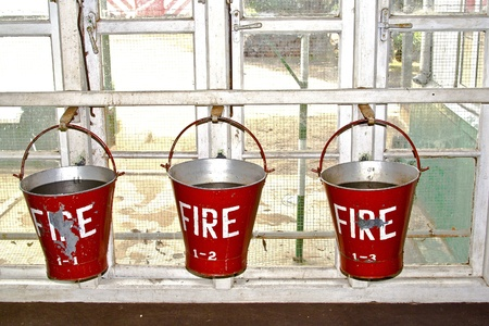 bucket with sand in a tea factory for fire fighting photo