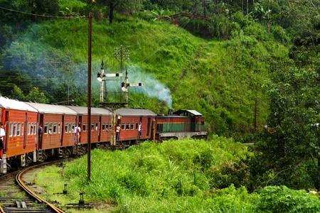 the historic train from Nuwara Eliya to colombo passes beautiful landscapes the scenic mountain track from Nuwarelia to Colombo on August 16,2005, Nuwarelia, Sri Lanka photo