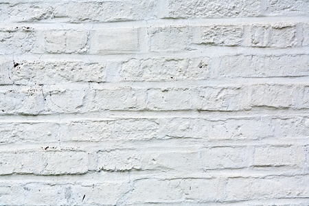 old white painted bricks at an old house wall photo