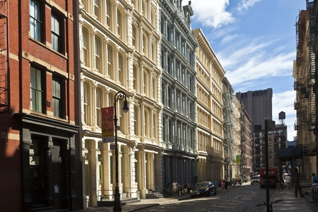 old building facade: beautiful Green Street in Manhattan with old houses, New York