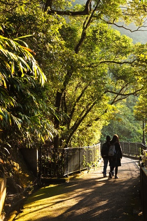 couple walks the romantic peak way in Hong Kong, Victoria photo