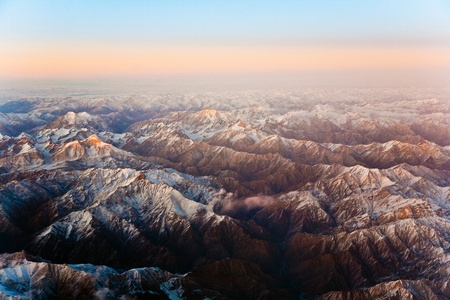 beautiful view from the aircraft to the mountains in Tashkent, china and Kirgistan, covered with snow Stock Photo - 9297932