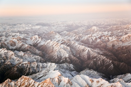 beautiful view from the aircraft to the mountains in Tashkent, china and Kirgistan, covered with snow Stock Photo - 9293942