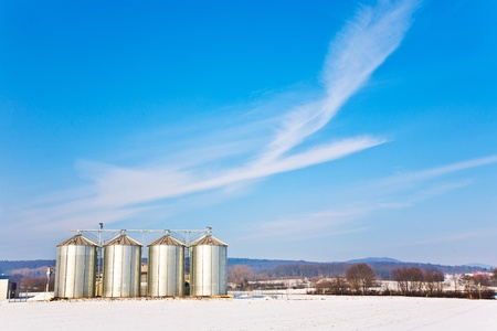 beautiful landscape with silo and snow white acre with blue sky Stock Photo - 9292572
