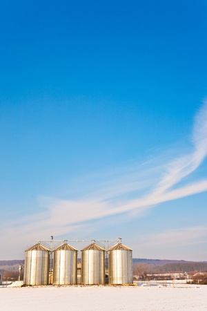 beautiful landscape with silo and snow white acre with blue sky Stock Photo - 9292327
