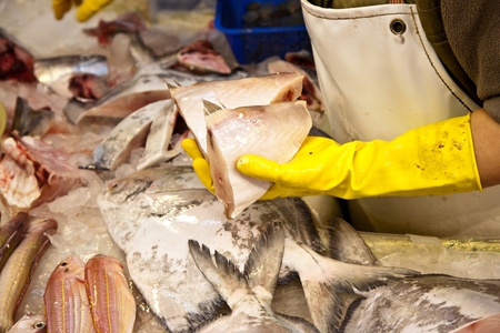 whole fresh fishes are offered in the fish market in asia Stock Photo - 9300505