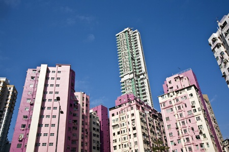 facade of houses downtown Kowloon with appartments photo