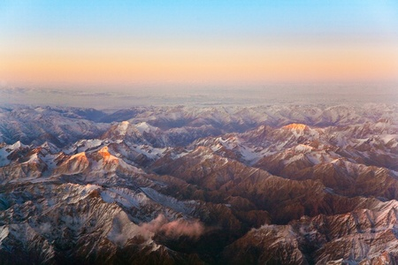 views of the mountains: beautiful view from the aircraft to the mountains in Tashkent, china and Kirgistan, covered with snow