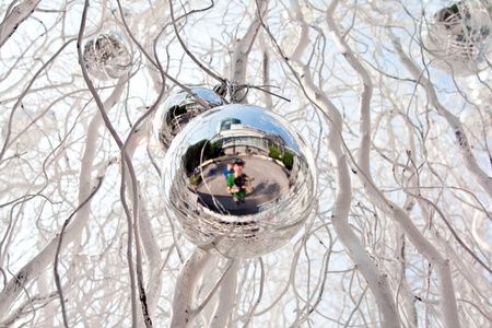 christmas tree balls and mirroring of father and sun with fun photo