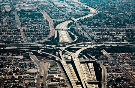 aerial city: landing at Los Angeles Airport with view to streets and huge crosing of freeway Stock Photo
