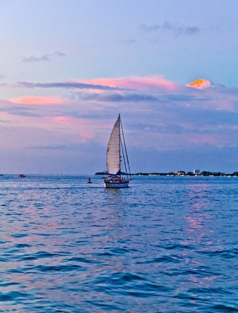 sailing boat in sunset in Key West photo