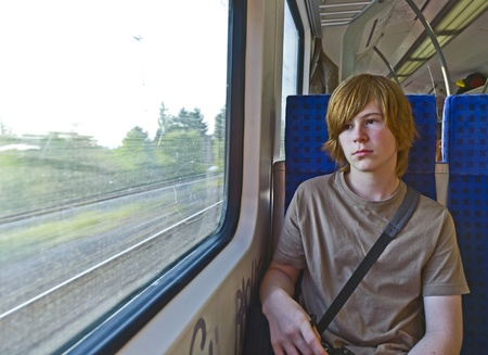 boy long hair: boy waiting in the station for the train Stock Photo