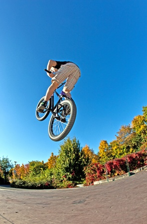 boy is going airborne with his dirt bike photo