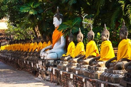 Buddha statues at the temple of Wat Yai Chai Mongkol in Ayutthaya near Bangkok, Thailand Stock Photo - 9325450