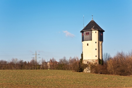 the water tower: old Water tower in beautiful landscape with blue sky Stock Photo