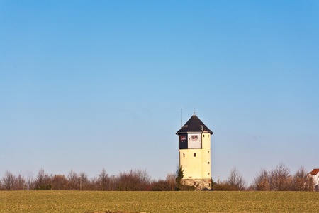 old Water tower in beautiful landscape with blue sky photo