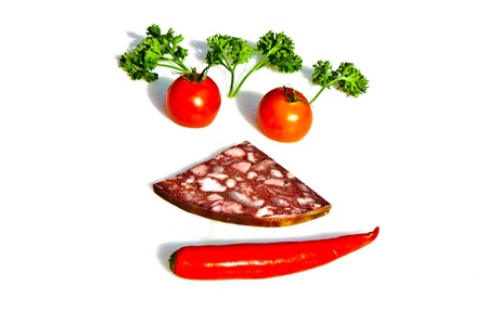 smiling face formed by meat and vegetables photo