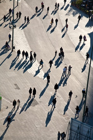 people walking in a pedestrian area seen from birds view, looking antlike photo