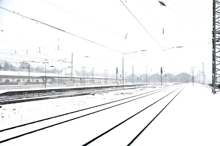 train in Wintertime on track in heavy snow flurry Stock Photo - 9343155