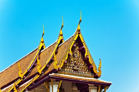 roof of monastery Wat Na Phramane in Ajutthaya with famous gold buddha and roof carvings photo