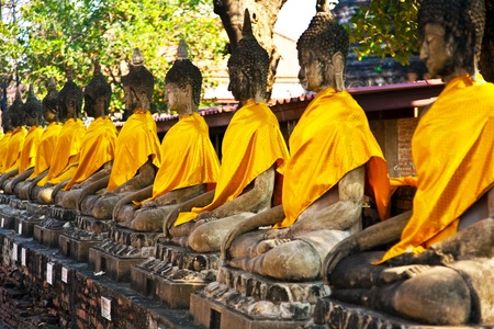 monks: Buddha statues at the temple of Wat Yai Chai Mongkol in Ayutthaya near Bangkok, Thailand Stock Photo