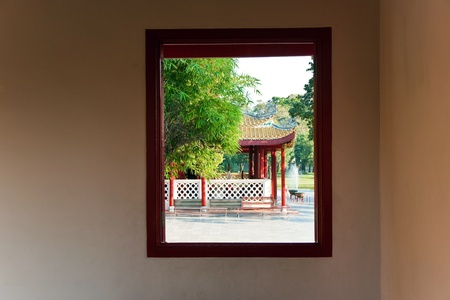 bang pa in: view out of a window to the park in the Summerpalace Bang Pa In of the King of Thailand near Ajuttaya