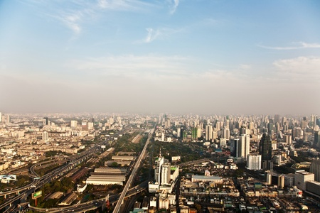 View across Bangkok skyline showing office blocks and condominiums photo