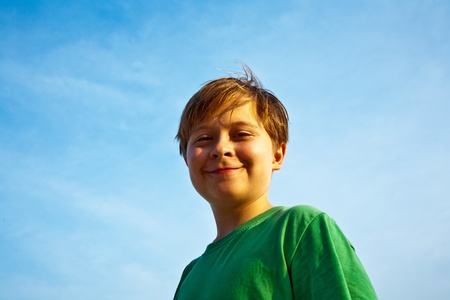 happy smiling young boy with background blue sky Stock Photo - 9349690