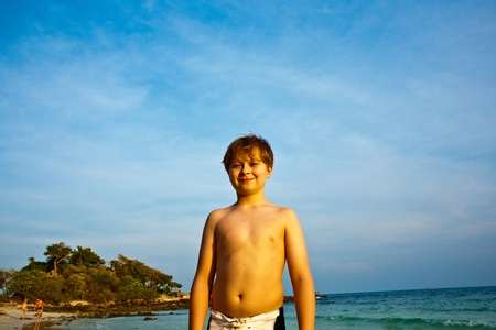 happy smiling young boy with background blue sky photo