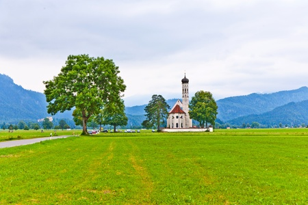 believing: typical bavarian landscape with a chapel Stock Photo