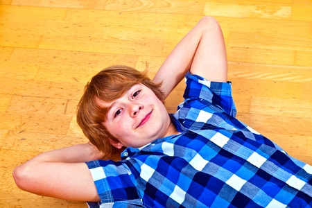 young boy lying at the floor photo