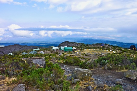 camp with heli landing port at hte Mount Kilimanjaro trail in Africa photo