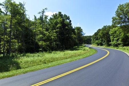road surface: Beautiful scenic country road curves through Shenandoah  National Park.