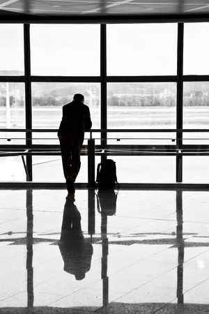 Man waiting for departure of his flight photo